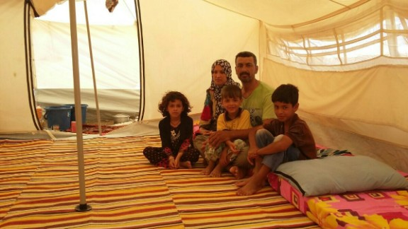 Mohammed, his wife and three children in the displacement camp of Amiriyat Al Fallujah
