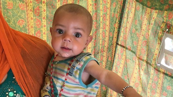 Baby Yousra at a refugee camp in Iraq