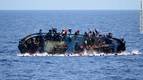 Migrants jump ship before their boat overturns off the Libyan coast on Wednesday, May 25.
