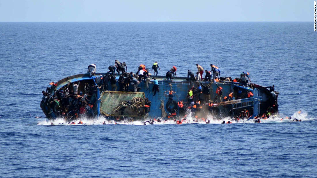 "A ship crowded with migrants <a href=""http://www.cnn.com/2016/05/25/middleeast/migrant-ship-overturns/"" target=""_blank"">flips onto its side</a> in May 2016 as an Italian navy ship approaches off the coach of Libya. Passengers had rushed to the port side, a shift in weight that proved too much. Five people died and more than 500 were rescued."