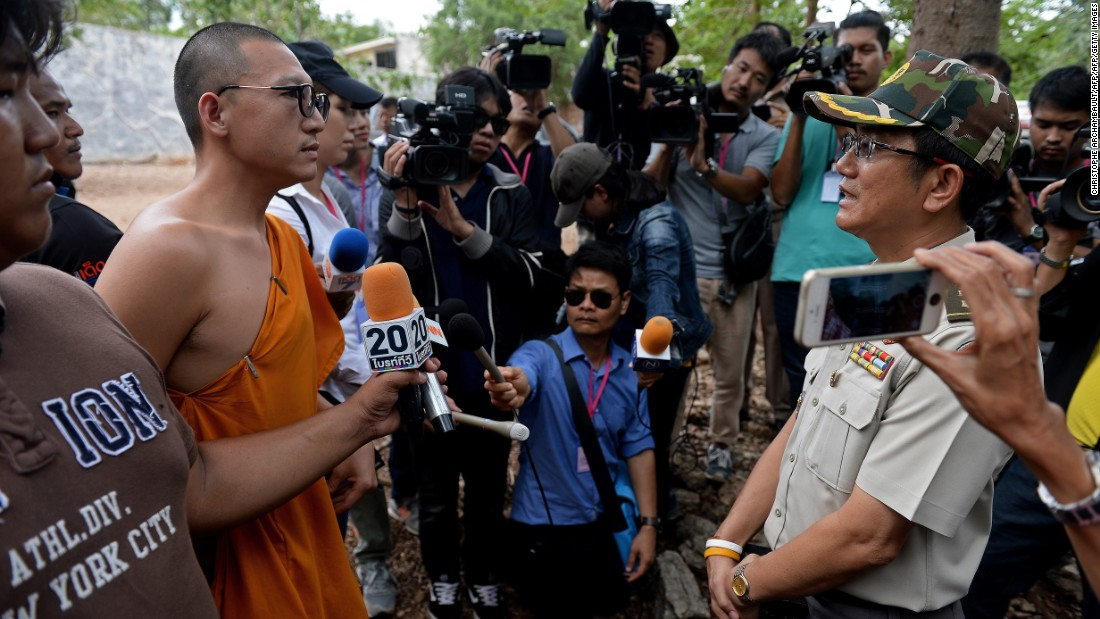 A Thai wildlife official speaks with a monk at the temple.