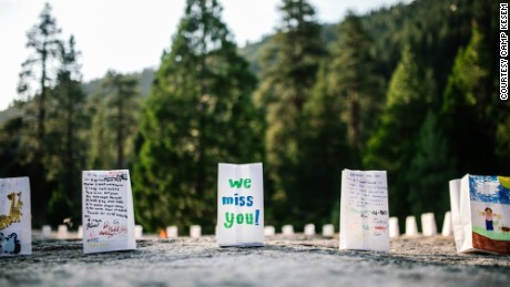 As part of an empowerment ceremony, campers can decorate luminaries with messages for loved ones.