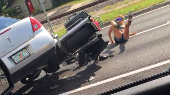 "The Florida Highway Patrol is investigating a wild hit-and-run caught on video in Tampa.    Cell phone video shows what appears to be a driver of a silver car deliberately plow down two people on a motorcycle.    The incident happened on US 41 and County Line Road around 5:35 p.m. on Monday.    According to witness, Abe Garcia, who captured the incident on video, the driver of the motorcycle confronted the driver of the car after he witnessed the car cut the motorcyclist off.    ""The guy driving the car was driving recklessly, like crazy out of control,"" Garcia said.  ""I saw him almost run one of the bikers over, like off the side of the road.  So, then the bikers caught up to him at a red light and words started exchanging, and then the guy went complete psychopath.""    That's when Garcia said the driver, who has not been identified, deliberately tried to run the man and woman over.    ""The guy tried to kill them,"" Garcia said.  ""It was a red light and then it turned green.  He could've just gone straight  but he went for the biker.""    Action News has reached out to the Florida Highway Patrol and is awaiting an official report.    Garcia said the driver was arrested down the road about five minutes later by FHP."