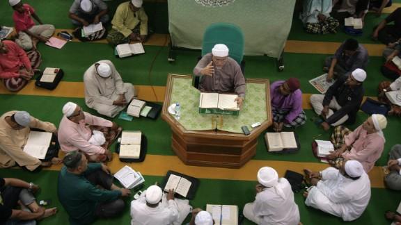 Pan-Malaysian Islamic Party president Abdul Hadi Awang during a weekly sermon on April 26, 2013.
