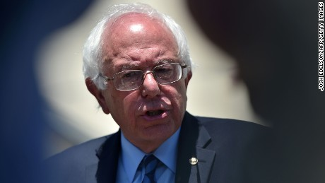 Bernie Sanders speaks to members of the press before being introduced at the Allen Temple Baptist Church in Oakland, California on May 30, 2016.