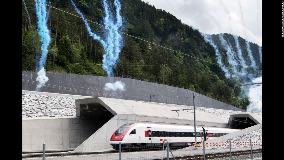 The first train comes out of the tunnel in Erstfeld.