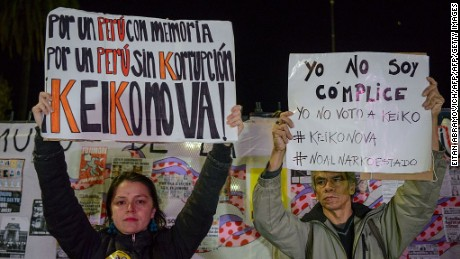 "Peruvians living in Argentina hold signs against Peruvian presidential candidate for the Fuerza Popular (Popular Strength) party Keiko Fujimori in Buenos Aires on May 31, 2016. Fujimori, daughter of former President (1990-2000) Alberto Fujimori, imprisoned on corruption and crimes against humanity, will face Pedro Pablo Kuczynski,  of the ""Peruanos por el Kambio"" (Peruvians for Change) party in next June 5 runoff elections. / AFP / EITAN ABRAMOVICH        (Photo credit should read EITAN ABRAMOVICH/AFP/Getty Images)"