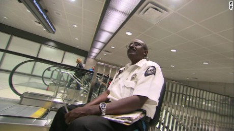 Yusuf Abdi Ali, working security at Dulles International Airport.
