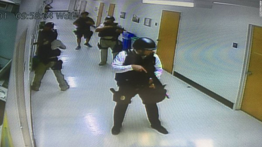 Law enforcement officials search a campus building on June 1. The photo was taken from one of the school's closed-circuit cameras.