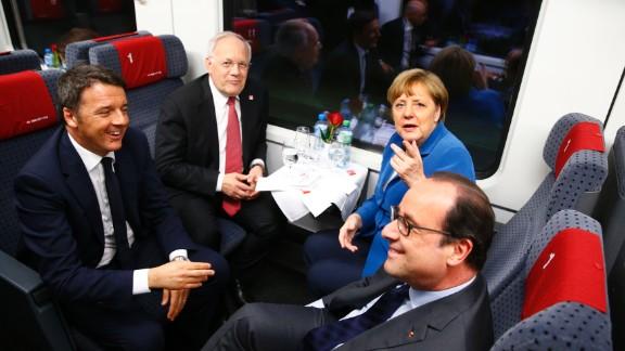 From left to right, Italian PM Matteo Renzi, Swiss President Johann Schneider-Ammann, Germany Chancellor Angela Merkel and French President Francois Hollande on board the maiden voyage on the line.