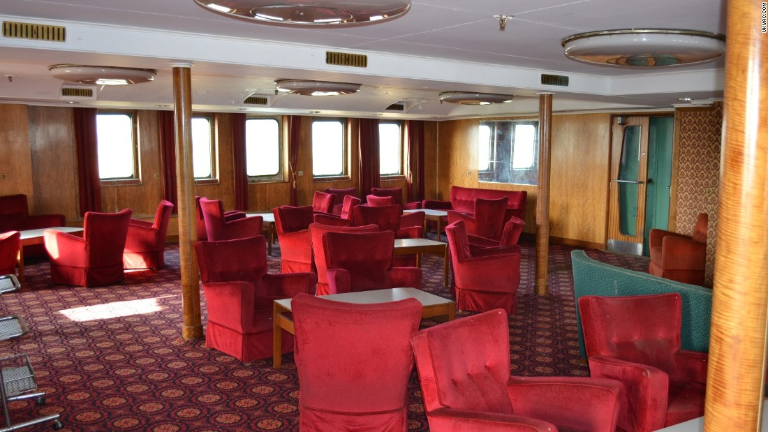 Interior of the once luxury cruise liner was carpeted with plush red velvet chairs. The & Explorers uncover classic arcade games on abandoned ship