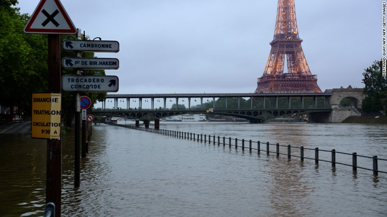 The Eiffel Tower looms over a flooded Seine river in Paris, June 1, 2016. Four bodies were found floating in homes in France and Germany after flash floods caused by heavy rains trapped people in their homes.