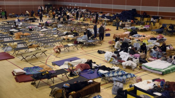 People wait in a Nemours gymnasium after evacuations.