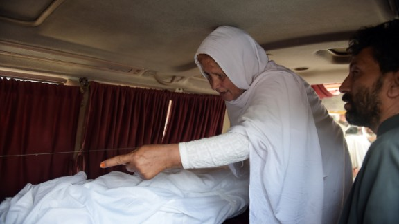 Maria's grandmother mourns next to her body in an ambulance outside a hospital in Islamabad.