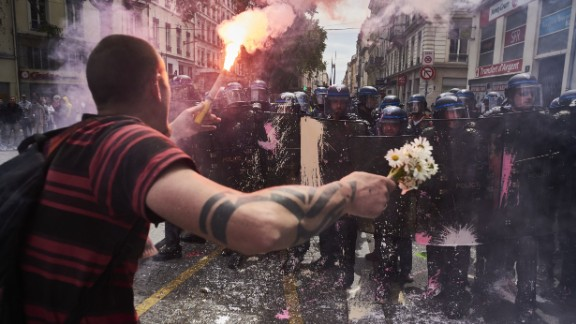 A man faces riot police during a labor protest last month in Lyons.