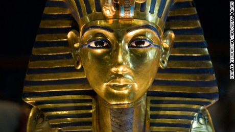 (FILES) -- A picture taken on October 20, 2009 shows King Tutankhamun's golden mask displayed at the Egyptian museum in Cairo. DNA testing has unraveled some of the mystery surrounding the birth and death of pharaoh king Tutenkhamun, revealing his father was a famed monotheistic king and ruling out Nefertiti as his mother, Egypt's antiquities chief said on February 17, 2010.  AFP PHOTO/KHALED DESOUKI        (Photo credit should read KHALED DESOUKI/AFP/GettyImages)