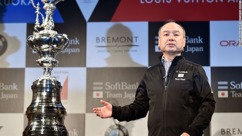 SoftBank Group Representative Masayoshi Son delivers a speech next to the America's Cup trophy during a press conference in Tokyo on June 2, 2016.  Fukuoka City, the Japan Sailing Federation and SoftBank Group Corp. announced the ninth race of the Louis Vuitton America's Cup World Series, a set of qualifiers for the 35th America's Cup to be held in 2017, will be held in Fukuoka, Japan from November 18 to 20. / AFP / KAZUHIRO NOGI        (Photo credit should read KAZUHIRO NOGI/AFP/Getty Images)
