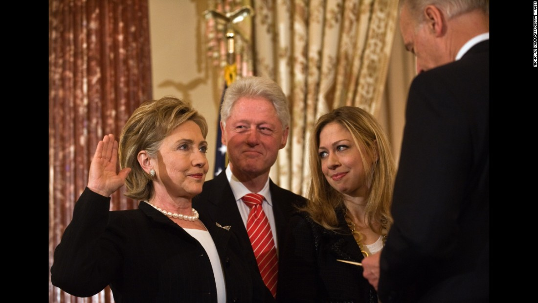Hillary Clinton is ceremonially sworn in as secretary of state by Vice President Joe Biden, as her husband, former President Bill Clinton, and daughter Chelsea look on at the State Department in Washington on February 2, 2009.