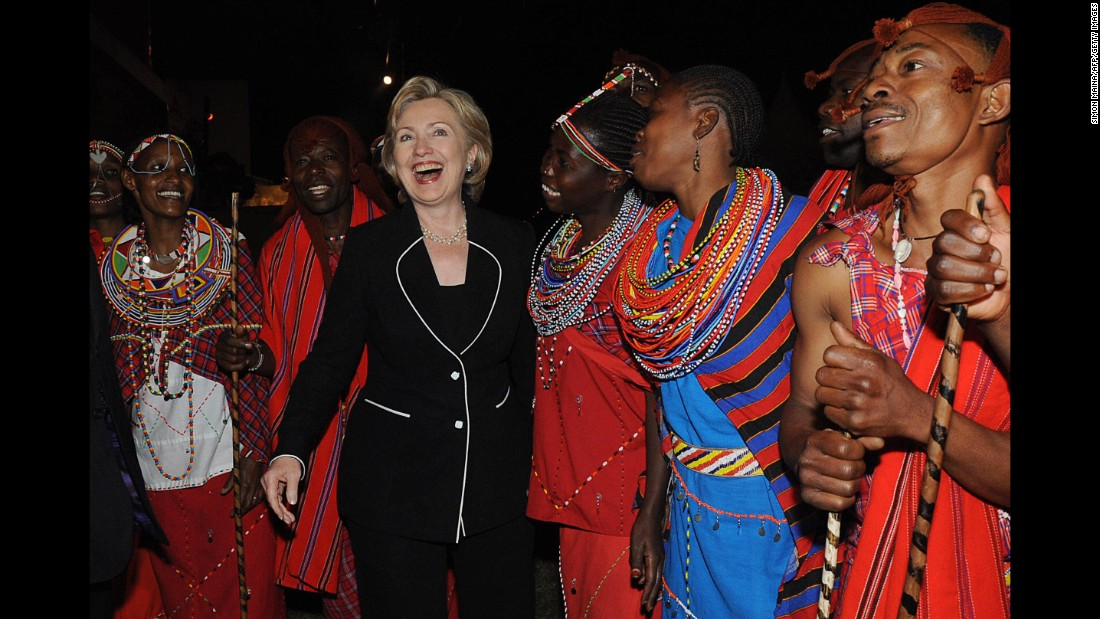 Clinton joins some of Kenya's Masaai traditional dancers before a dinner hosted in her honor on August 5, 2009.