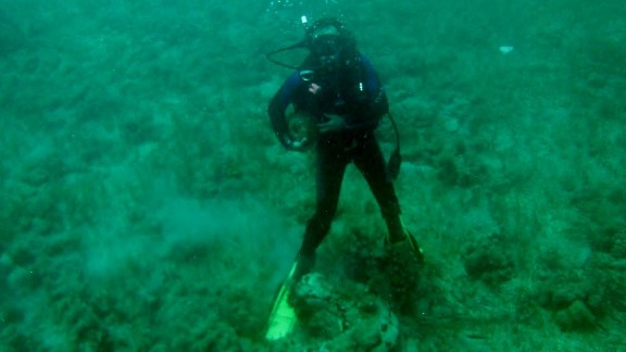 Research teams investigate the content and texture of the underwater formation.