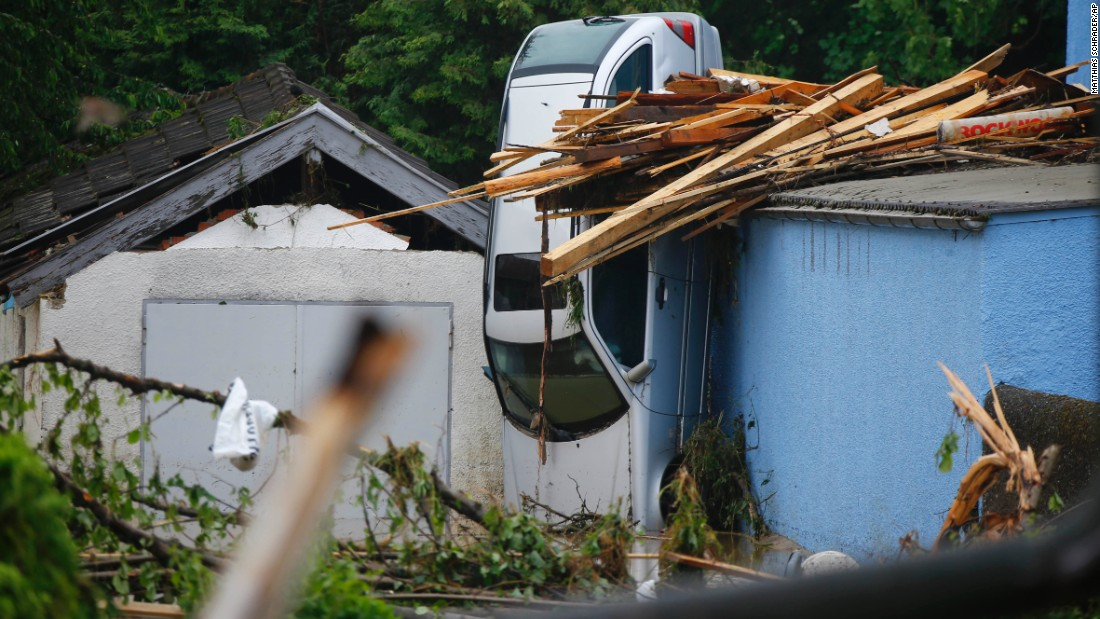 A car stands against the side of a house Thursday, June 2, after flooding in Simbach am Inn, Germany.