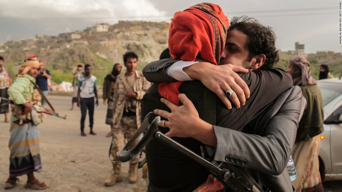 A tribesman from the Popular Resistance Committees -- forces loyal to Yemeni President Abdu Rabu Mansour Hadi -- is greeted by a comrade in Taiz, Yemen, after a prisoner exchange with Houthi rebels on Wednesday, June 1. The Yemeni civil war began in March 2015 after Houthis seized the presidential palace in Aden.