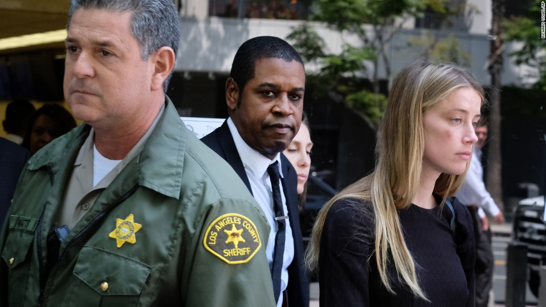 "Actress Amber Heard leaves Los Angeles Superior Court on Friday, May 27, after giving a sworn declaration that her husband, actor Johnny Depp, had been abusive. A judge <a href=""http://www.cnn.com/2016/05/27/entertainment/amber-heard-johnny-depp-restraining-order/"" target=""_blank"">granted a temporary restraining order</a> to Heard, who has also filed for divorce. As part of the court documents, Depp filed a ""memorandum of points and authorities"" in which he rejected Heard's claims of domestic violence."