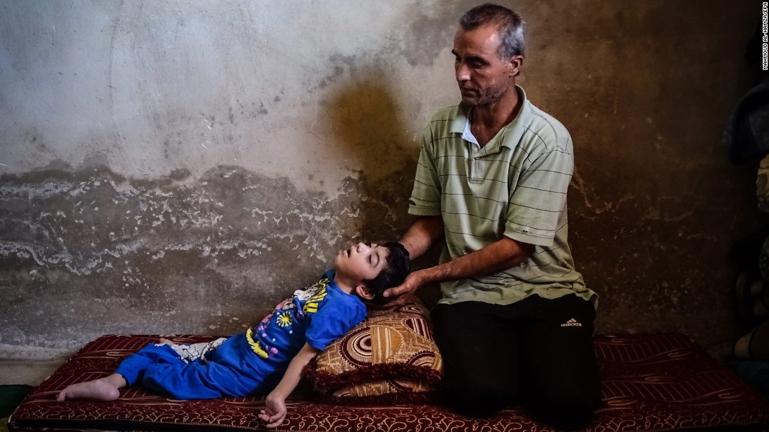 "A man named Ahmed sits next to his daughter Reem at their home in Daraa, Syria, on Monday, May 30. Ahmed says Reem is disabled because of injuries she sustained when their home was shelled two years ago. <a href=""http://www.cnn.com/2015/05/22/world/gallery/syria-civil-war-pictures/index.html"" target=""_blank"">Syria's civil war in pictures</a>"