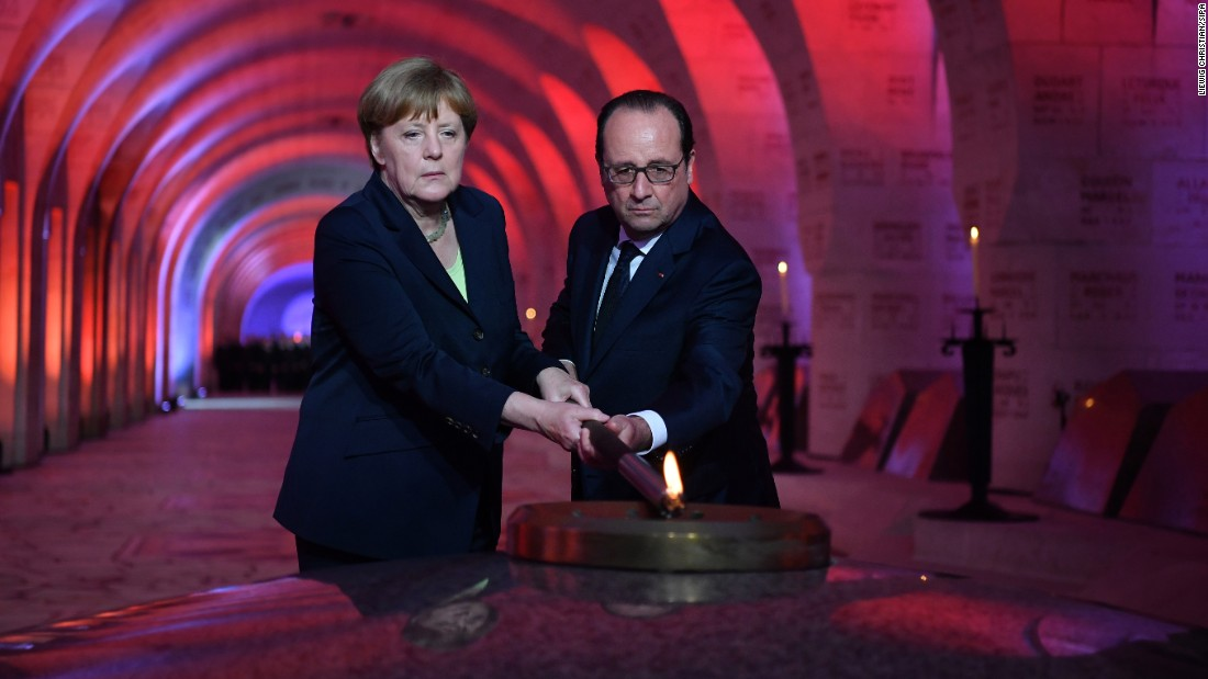 German Chancellor Angela Merkel and French President Francois Hollande rekindle the flame at a national necropolis near Verdun, France, on Sunday, May 29. One hundred years ago, Germany and France fought the Battle of Verdun during World War I. There were more than 300,000 casualties between the two countries.