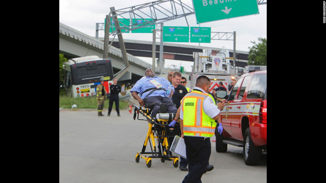 "A man is stretchered away for medical attention after the bus he was riding in <a href=""http://www.chron.com/news/houston-texas/houston/article/Metro-bus-crash-injures-several-near-downtown-7957338.php#photo-10173489"" target=""_blank"">was involved in a major wreck</a> in Houston on Wednesday, June 1. The bus collided with a pickup truck and slammed into the post of a highway sign. Dozens of people were injured."