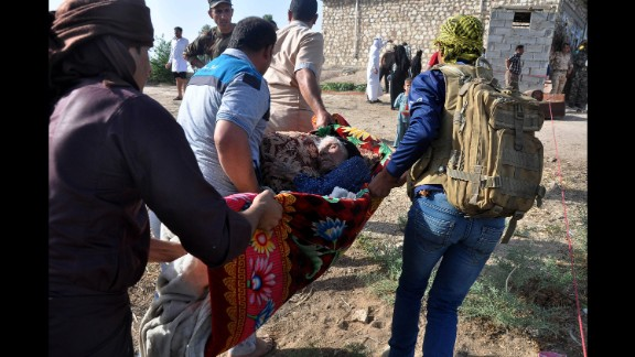 Internally displaced civilians flee their homes after crossing the Euphrates River outside Falluja on Thursday, June 2.