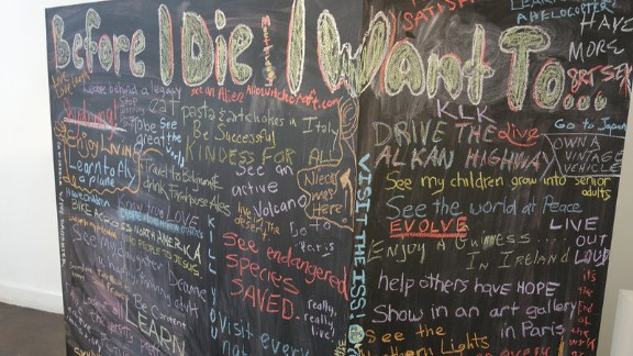 "A chalkboard ""bucket list"" stirred imaginations and got people talking at an Indianapolis festival designed to help make conversations about death easier. (Jake Harper/WFYI)"