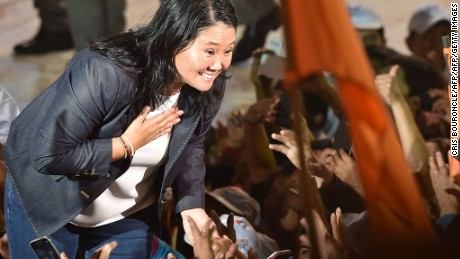 "Peruvian presidential candidate for the ""Fuerza Popular"" (Popular Strength) party, Keiko Fujimori, waves to sypathizers during her closing campaign rally in Lima on June 2, 2016. Fujimori will face Pedro Pablo Kuczynski of ""Peruanos por el Kambio"" (Peruvians for Change) party in June 5th runoff election. / AFP / CRIS BOURONCLE        (Photo credit should read CRIS BOURONCLE/AFP/Getty Images)"
