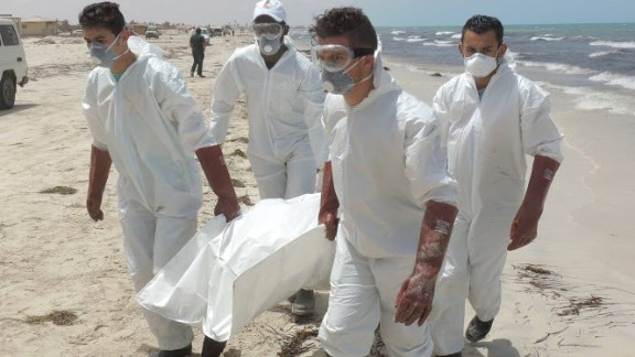 Volunteers carry bodies for burial after they washed ashore this week in Libya.