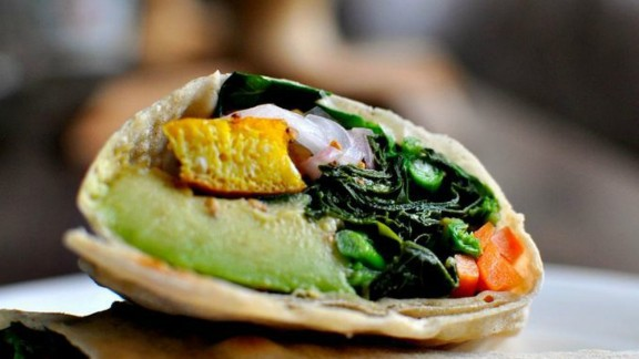 """So while predictions may look dire, Haddad says the future could look brighter, if policymakers take action and people begin to reach for healthier options. """"It's not fate or destiny. There are choices.""""   Pictured here, a Rolex, which is a popular dish in Uganda made from a rolled chapatti containing a fried egg and some vegetables, is wildly popular in Uganda, but little known outside the country."""