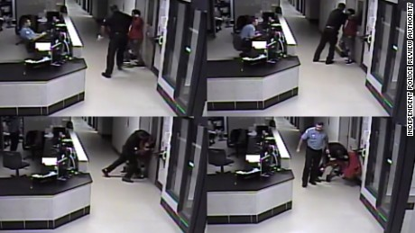 Screenshots from a video appear to show an officer grab Albert Payne's neck.