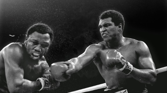 Muhammad Ali connects with a right in the ninth round challenger Joe Frazier during title fight in Manila, Philippines, October 1, 1975.  Ali won the fight on a decision to retain the title.