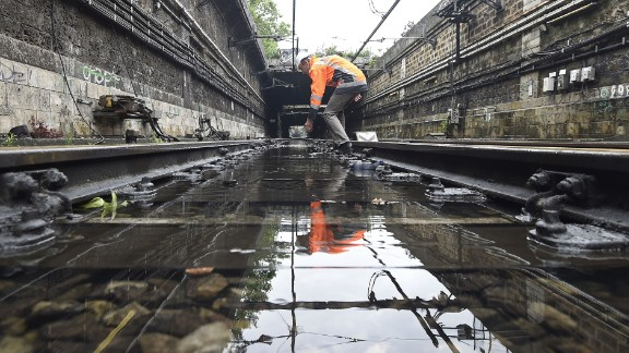 A technician assesses flood damage on railway  tracks in Paris on Saturday, June 4. The rain-swollen Seine river receded Saturday for the first time in a week after nearing its highest level in three decades.