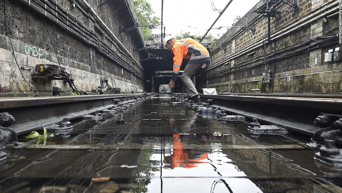 "A technician assesses flood damage on railway  tracks in Paris on Saturday, June 4. <a href=""http://www.cnn.com/2016/06/04/europe/france-germany-floods/index.html"" target=""_blank"">The rain-swollen Seine river receded Saturday for the first time in a week after nearing its highest level in three decades. </a>"