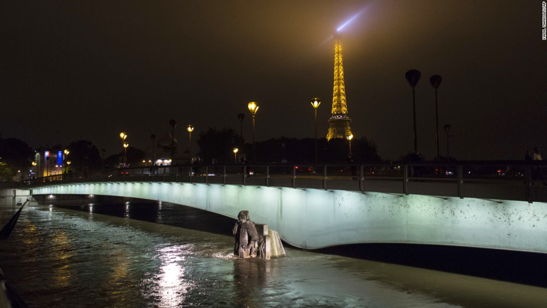 The Zouave statue at Pont de l'Alma, which serves as a measuring instrument for water levels, is partly submerged by the Seine on Friday, June 3.