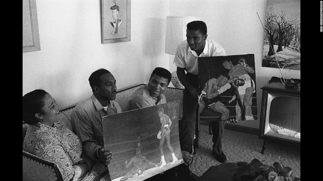 The family displays Cassius Sr.'s paintings in the living room of Ali's Louisville home in 1963.