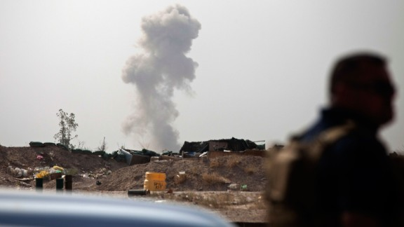 Smoke rises on the front line of fighting between ISIS militants and pro-government Iraqi fighters on Sunday, June 5.