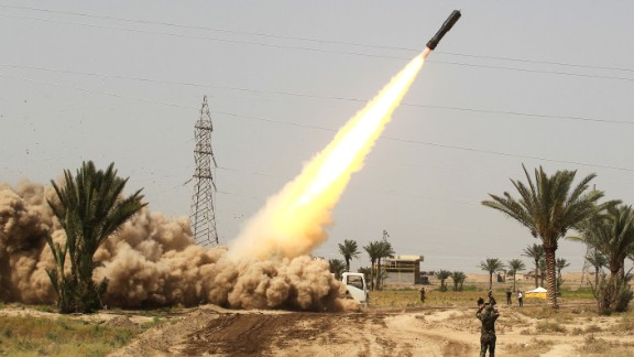 Pro-government forces and Shiite militia fighters fire rockets toward ISIS fighters in Falluja on Saturday, June 4.