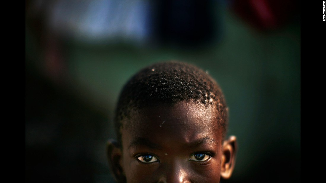 "Alex Mertulus, 10, was one of the many Haitians displaced by the 2010 earthquake. During Gilkey's career, he also covered war in Iraq, the Ebola epidemic in Liberia and the end of apartheid in South Africa. ""He was a master storyteller of all types and genres,"" CNN's Ivan Watson said. ""Who else could come to a nonprofit radio organization like NPR and carve out a niche for award-winning photography?"""