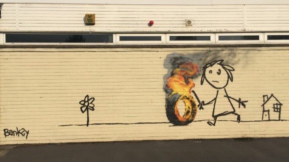 In June 2016 elusive UK street artist Banksy painted this mural for students at a primary school in his hometown of Bristol, England. Students had named a house at their school for the artist, who surprised them with the mural when they returned from a holiday break. Here's a look at some other notable Banksy works.