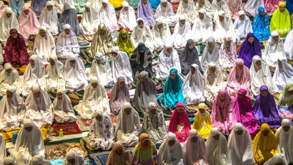 Muslims hold prayers at the al-Akbar mosque in Surabaya, Indonesia, to mark the start of Ramadan on June 5.
