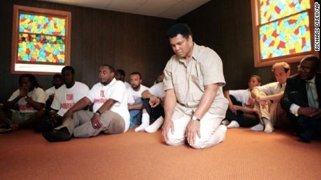 Muhammad Ali prays at a mosque in Deer Lake, Pennsylvania, in 1991.