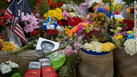 Flowers and memorabilia are seen at a memorial for boxing legend Muhammad Ali at the Mohammad Ali Center June 6, 2016 in Louisville, Kentucky. / AFP / Brendan Smialowski        (Photo credit should read BRENDAN SMIALOWSKI/AFP/Getty Images)