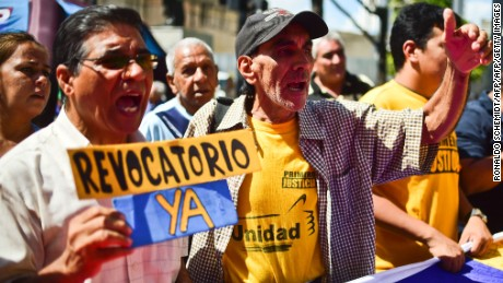 People shout slogans during an opposition demonstration for a recall vote, in Caracas, on June 6, 2016. Venezuela's opposition held new protests, seeking to convert widespread anger over food shortages and economic havoc into pressure for a referendum on removing embattled President Nicolas Maduro. / AFP / RONALDO SCHEMIDT        (Photo credit should read RONALDO SCHEMIDT/AFP/Getty Images)
