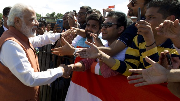 Modi shakes hands with supporters in Washington upon his arrival on June 6.